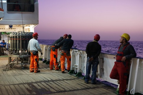 Figure 2. The crew and scientists assemble for a CTD cast at dusk.