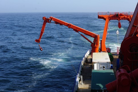 Figure 1. The towed fish surface water sampler leaves a wake in the clear blue south Atlantic.