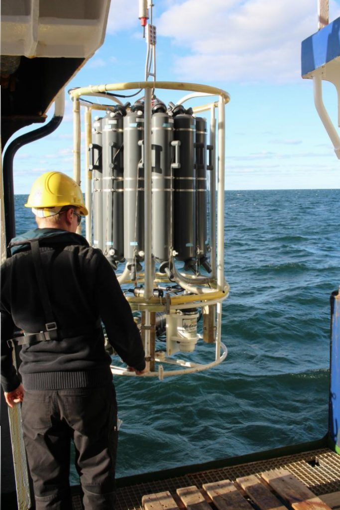 The CTD is released into the water by a crew member of the RV Poseidon to take measurements of water column properties. Photo by Nora-Charlotte Pauli