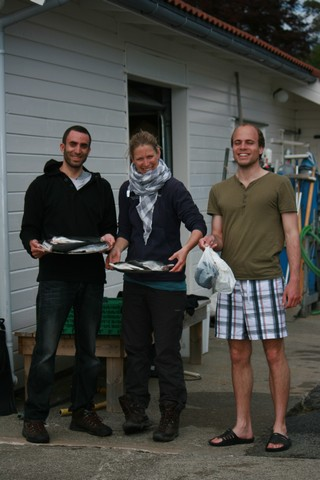 Some members from the fishing and preparation team. With their proud catch! Photo by Serra Orey