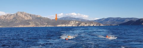 The position of a land seismometer on Corsica is marked by the orange arrow. In the water the orange bulbs mark the position of our airguns. Photo: A. Paul, ISTerre.