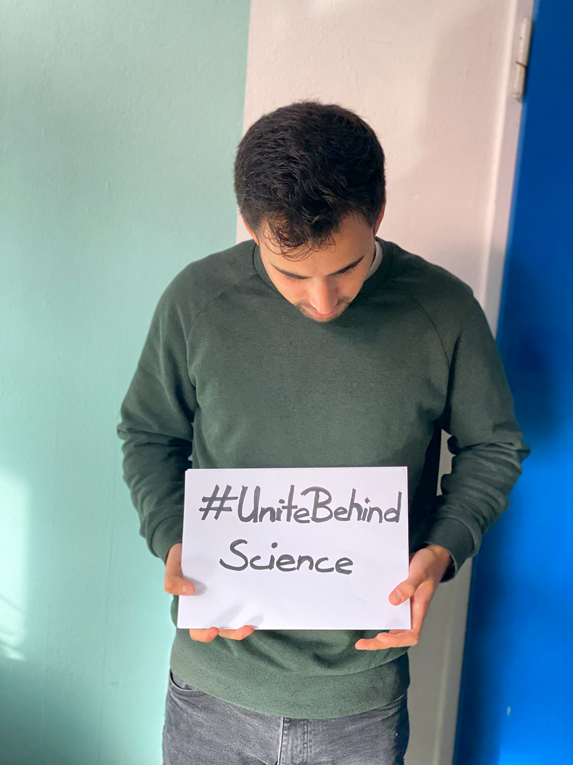 Joaquin holding a climate sign