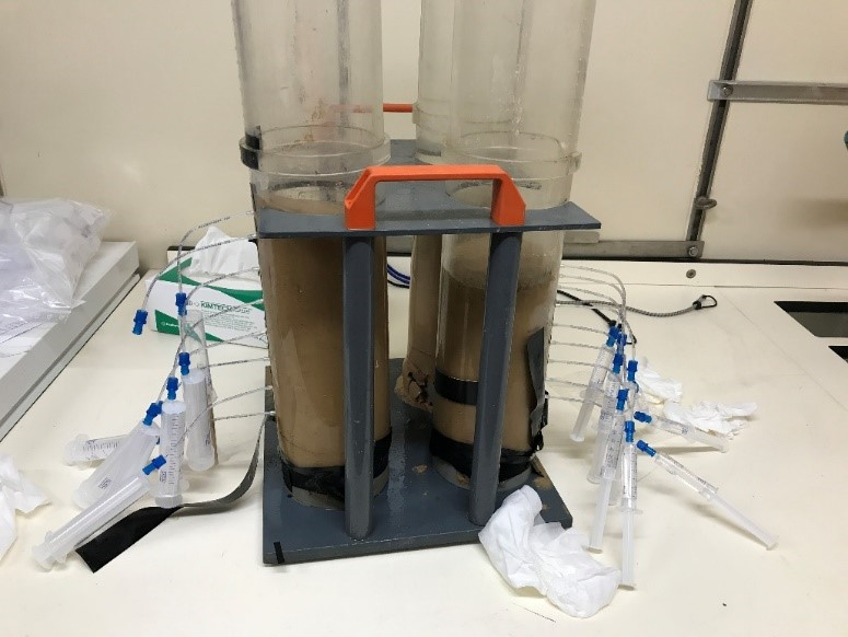 Photo 3: Extracting porewaters from the core with Rhizons and syringes (Photo Z Zhang)