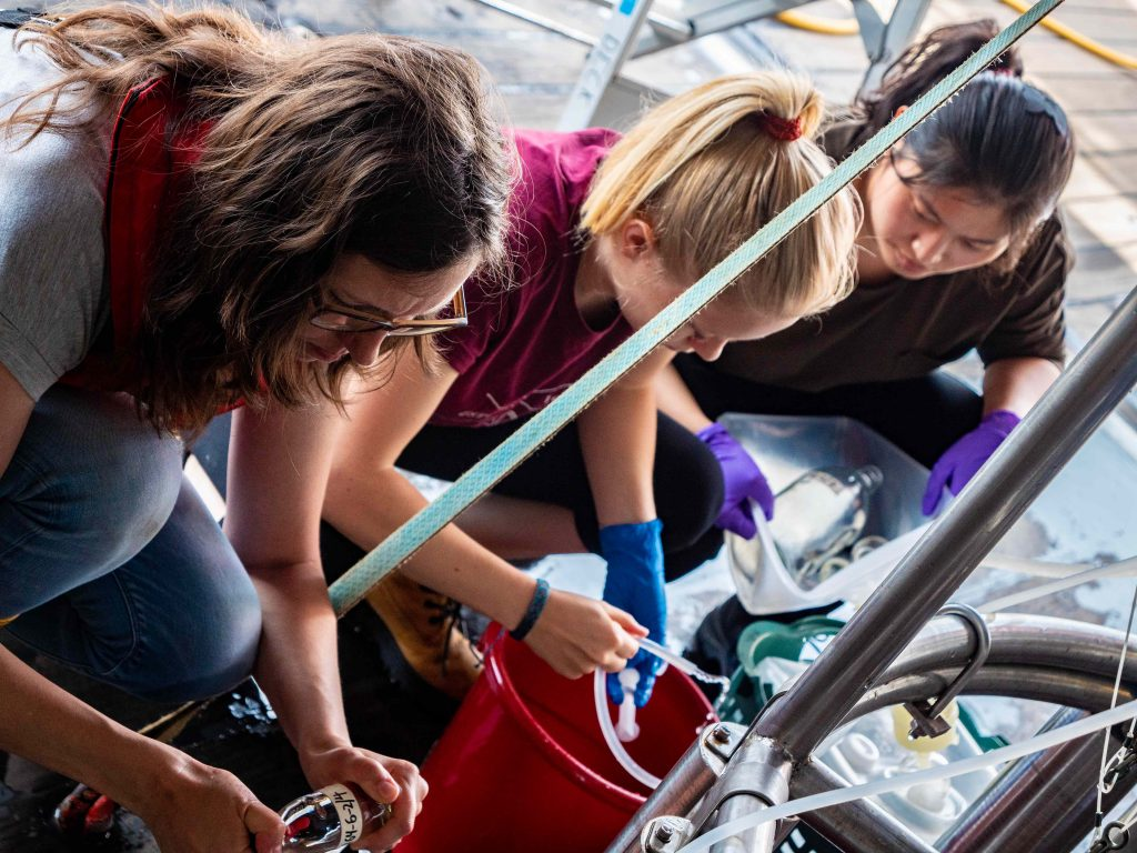 Scientists take water samples from the watertanks of the CTD. Photo: Steffen Niemann